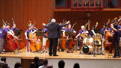 Student bass orchestra conducted by Rufus Reid