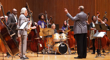 Student bass orchestra conducted by John Clayton, with Gary Bartz, sax, Gerald Cannon, bass, and Billy Hart, drums